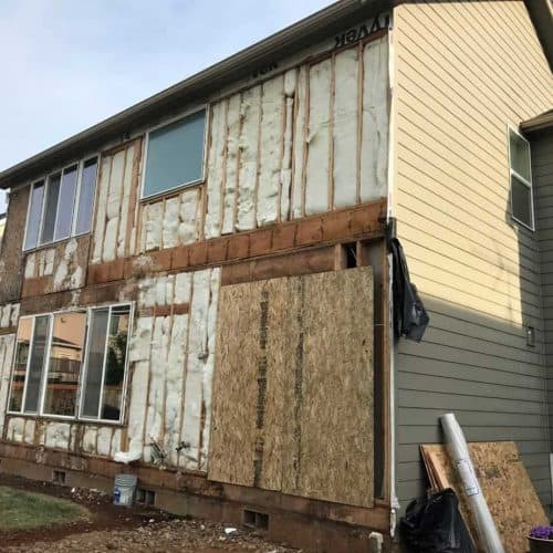 Upon further inspection, it was determined that the windows needed to be pulled and reset correctly, and the home would receive new house wrap and new siding on the sides where the issues were predominant.